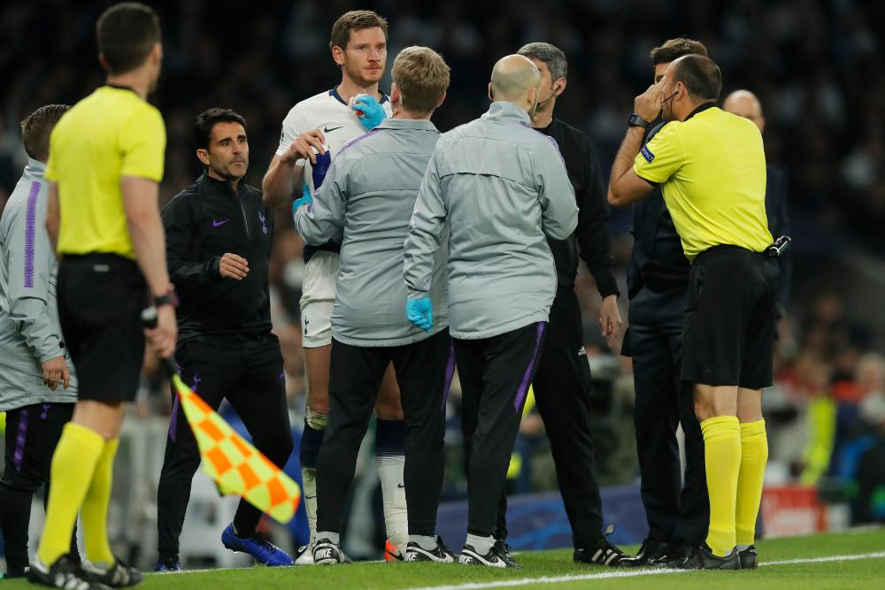 Tottenham's Jan Vertonghen is checked for concussion.