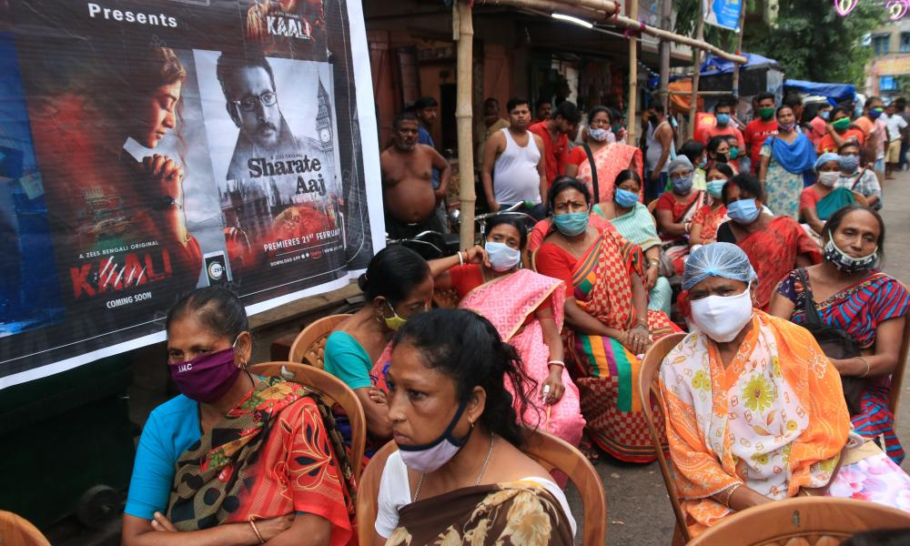 Indian sex workers wearing face masks as a precaution against coronavirus gather to worship Hindu goddess Durga at a worship place set up at Sonagachhi, a red light district, in Kolkata, India.