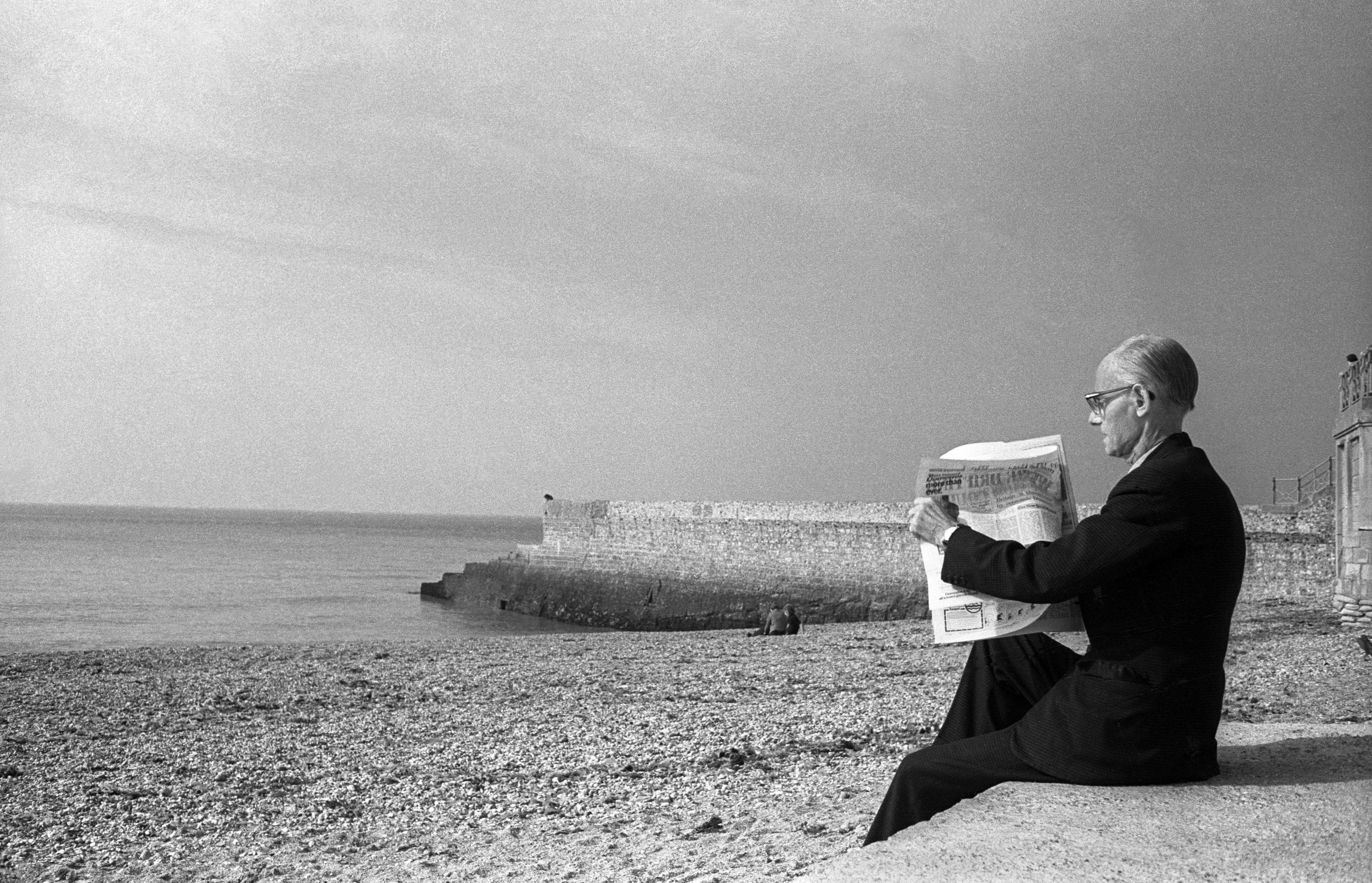 The big picture: a suited man on Brighton beach