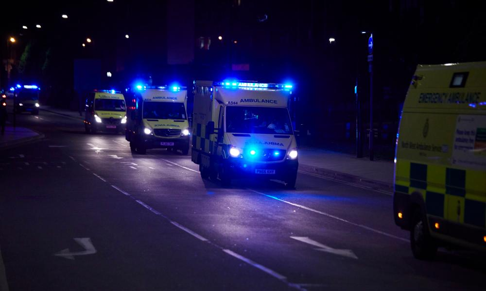 MANCHESTER, 23 May 2017 - A fleet of ambulances arriving at Manchester Victoria railway station and arena where two suspected bomb explosions are reported to have killed at least 19 concert goers as they left a performance by Ariana Grande. Christopher Thomond for The Guardian.