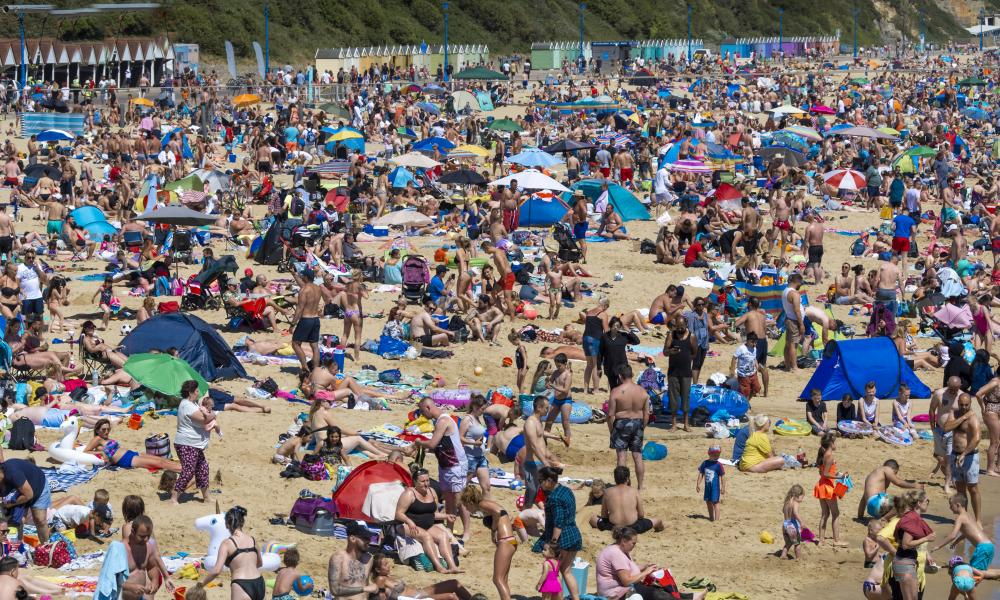People on the beach at Bournemouth yesterday.