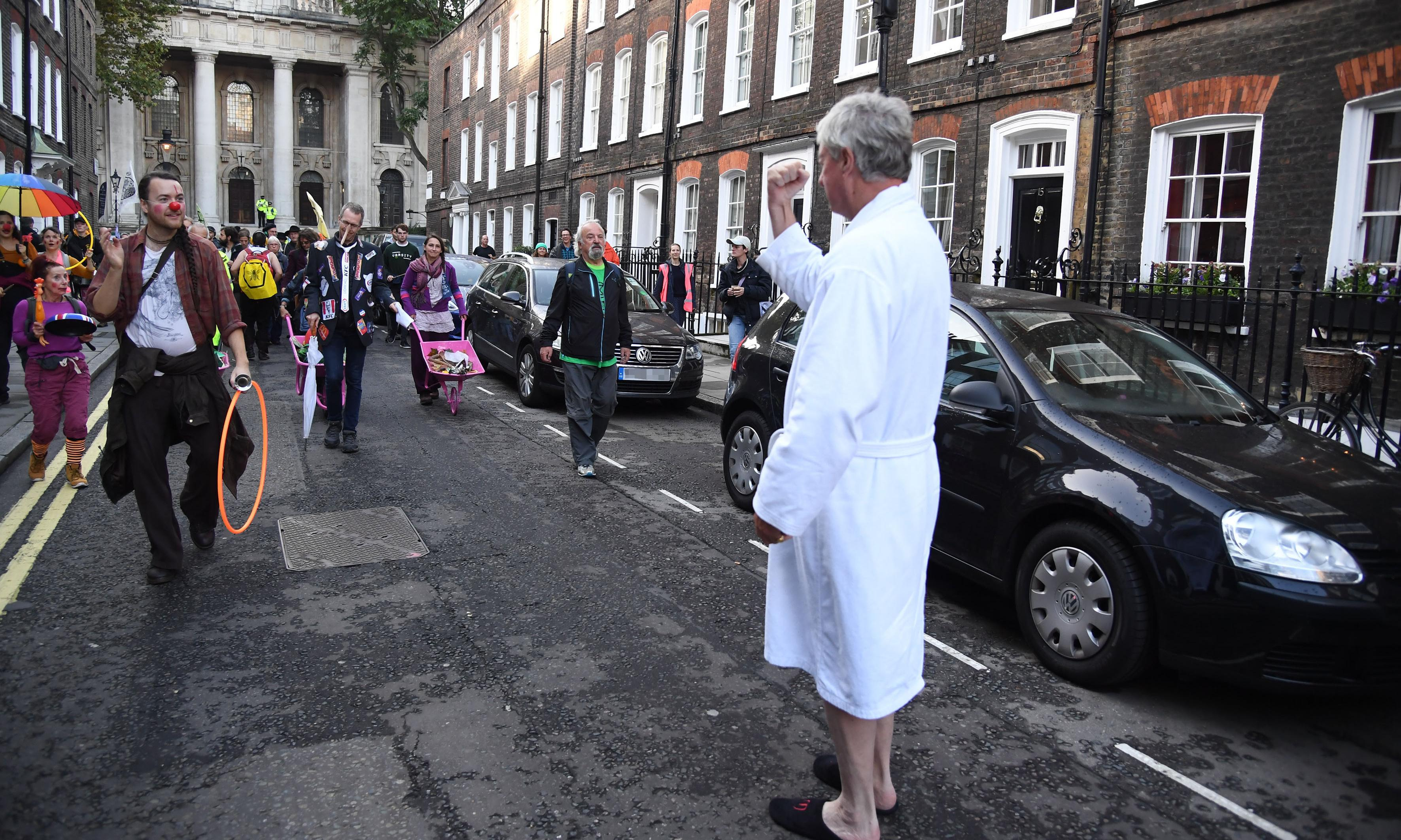 Tory peer in dressing gown confronts Extinction Rebellion activists