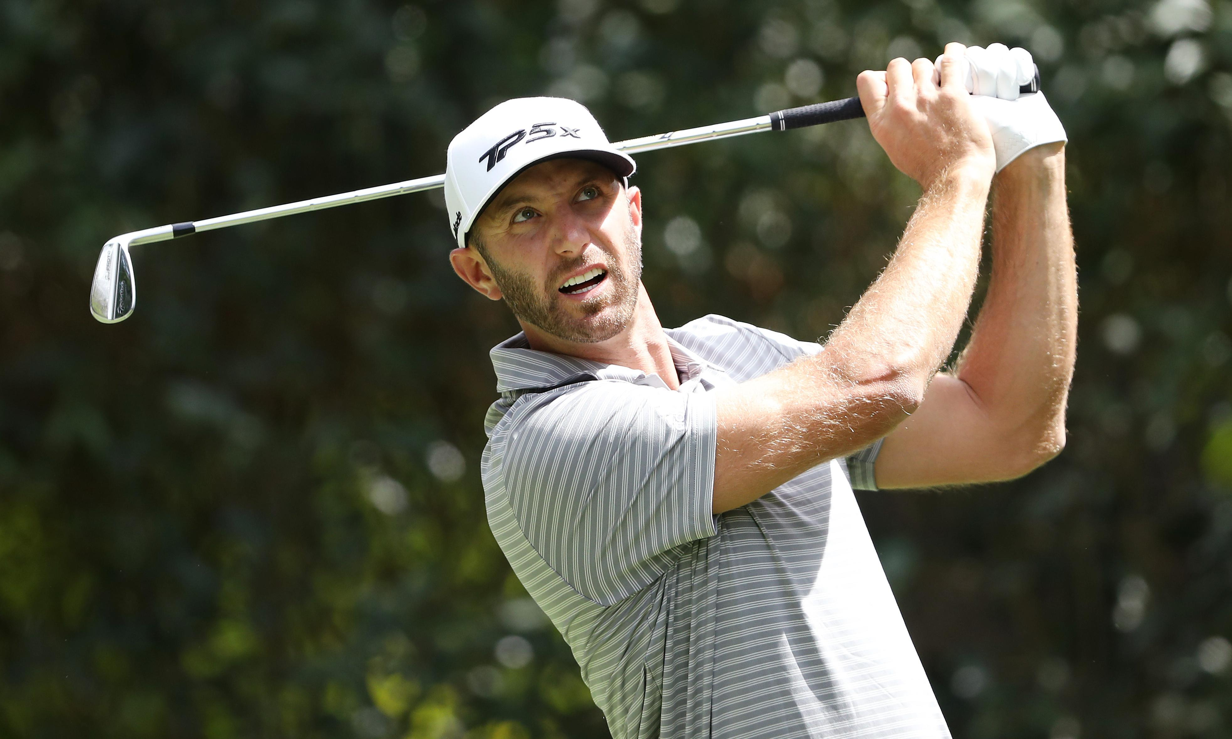 Dustin Johnson takes command as Rory McIlroy struggles on the greens