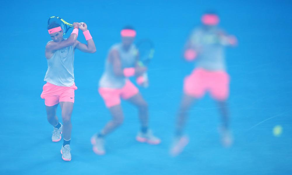 A multiple exposure shot of Rafael Nadal firing a backhand to Victor Estrella Burgo.