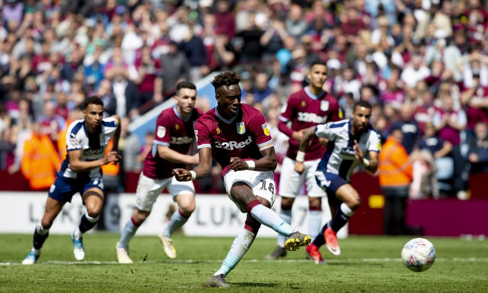 Tammy Abraham dispatches his penalty with aplomb to give Aston Villa the lead.