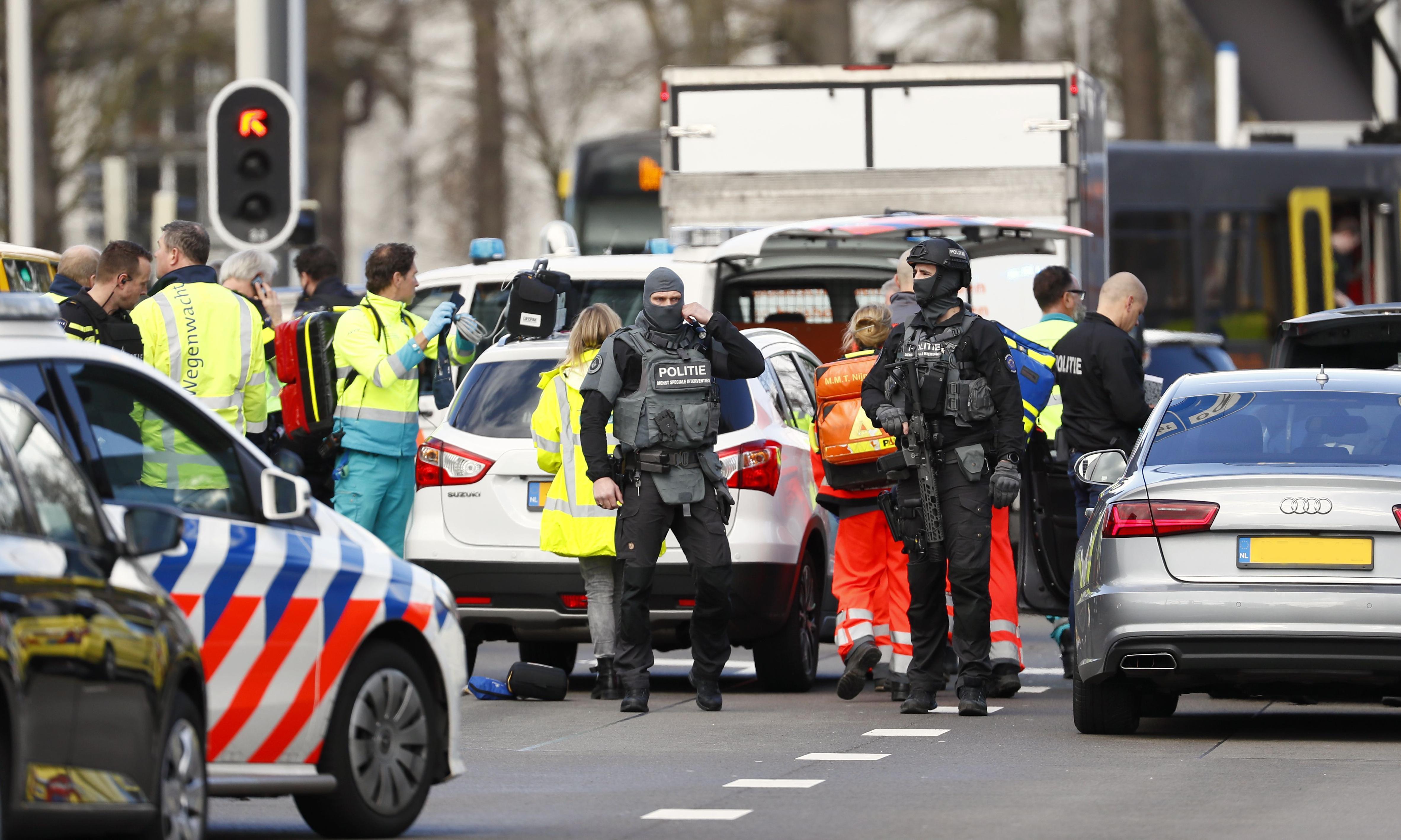 Utrecht tram shooting: three dead as police hunt gunman