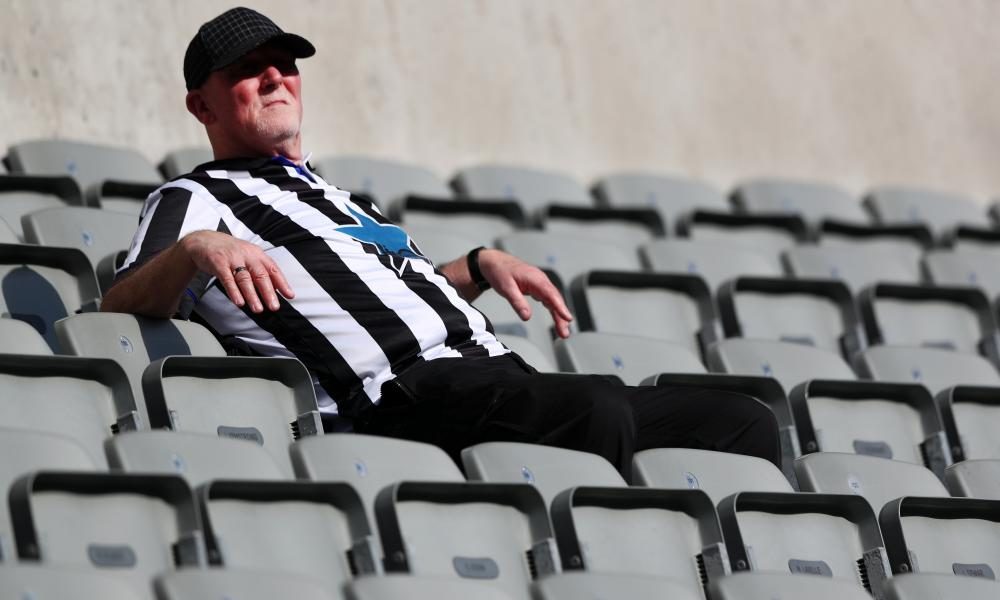 A Newcastle fan enjoys the sun