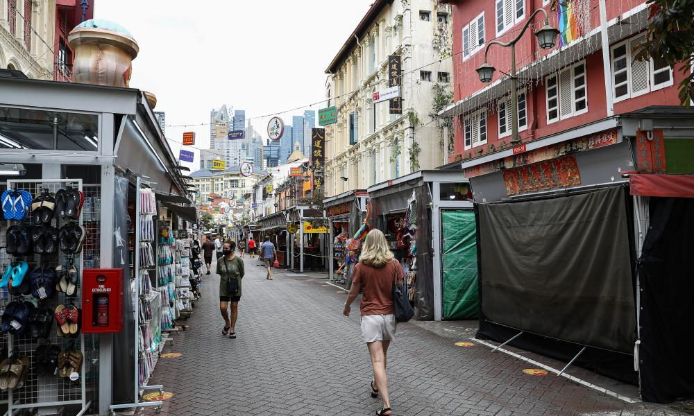 General view of shops with very little human traffic in Chinatown, Singapore.