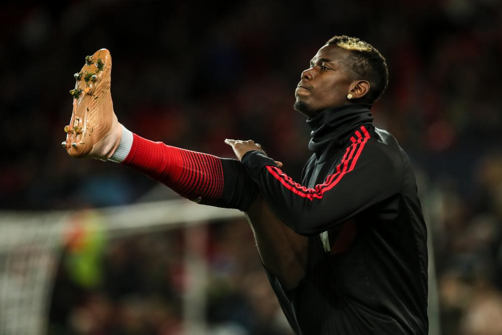 Paul Pogba warms up prior to the match.