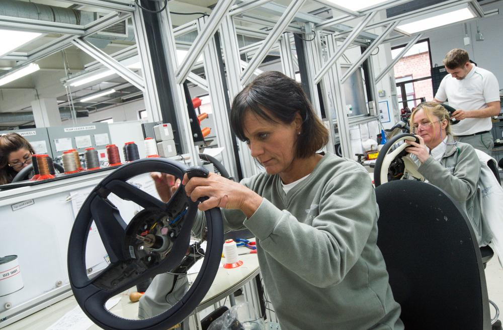 Bentley employees make steering wheels