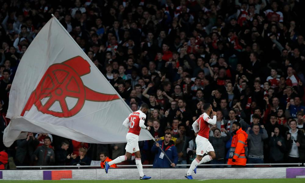 Alexandre Lacazette celebrates his, and Arsenal's, second goal in front of the happy Gooners.