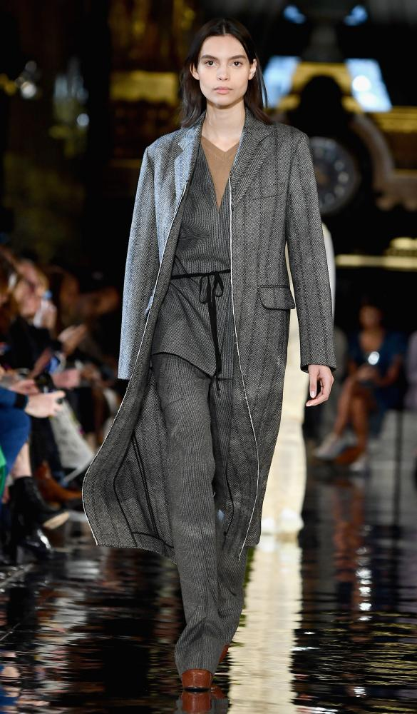 Stella McCartney – grey suit under grey coat.