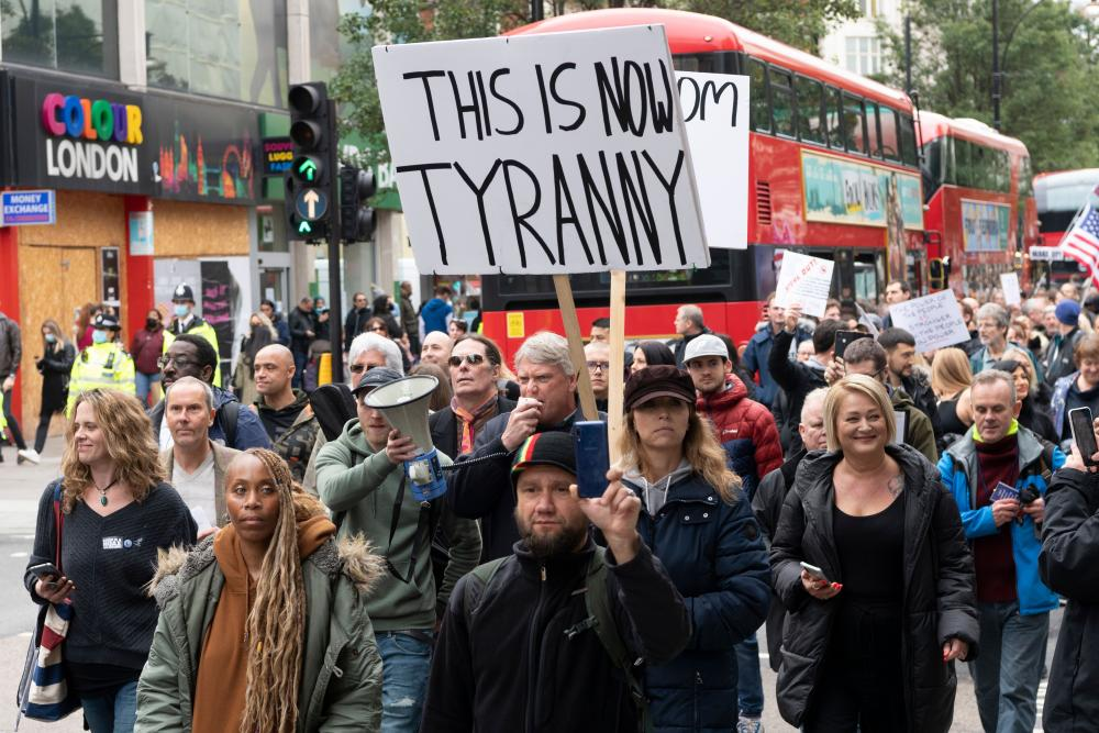 Protesters take part in the March For Freedom demonstration organised by Stand Up X in London. The group are against the Covid-19 restrictions, including the wearing of face masks and the erosion of civil liberties.