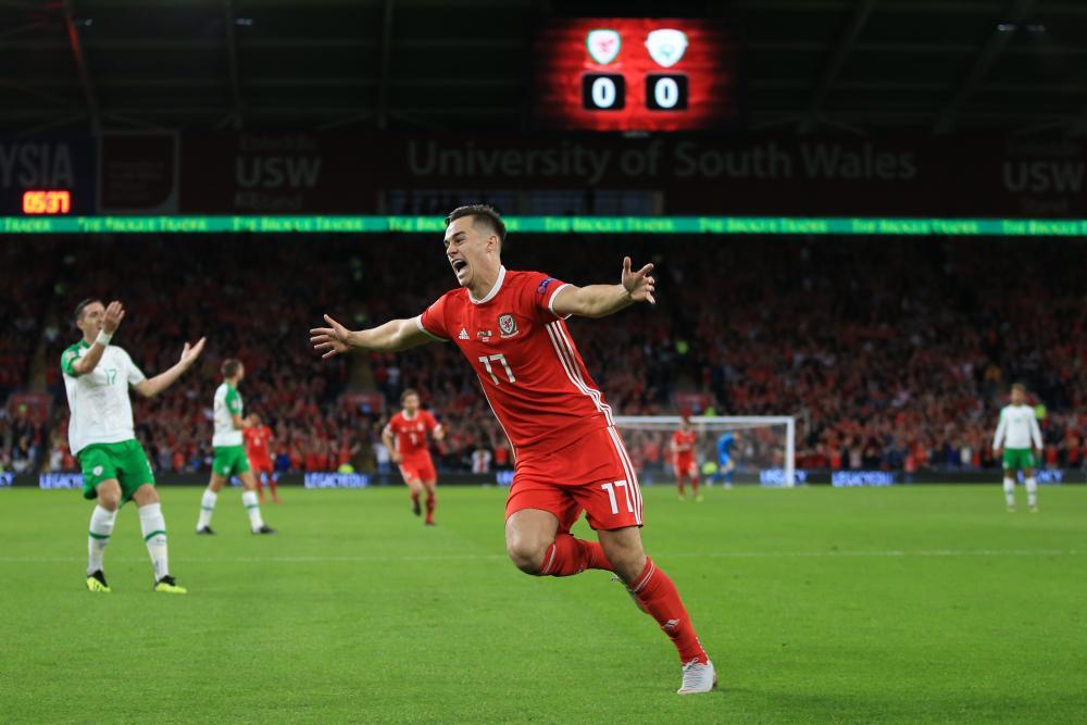 Tom Lawrence of Wales celebrates scoring the opening goal.
