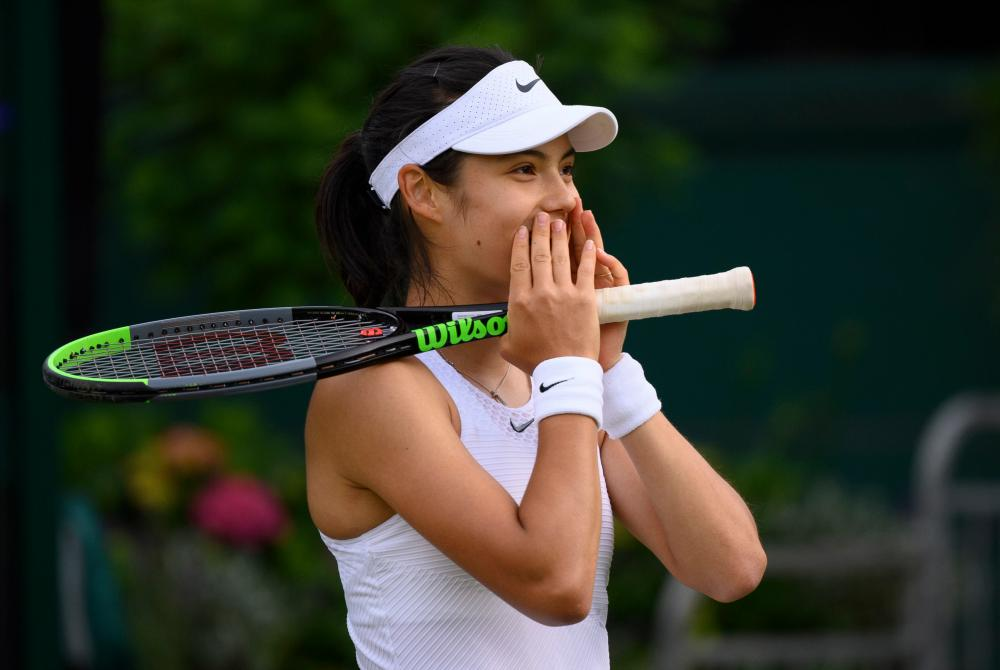 Emma Raducanu reacts after defeating Vitalia Diatchenko in the first round of the singles at Wimbledon in 2021.