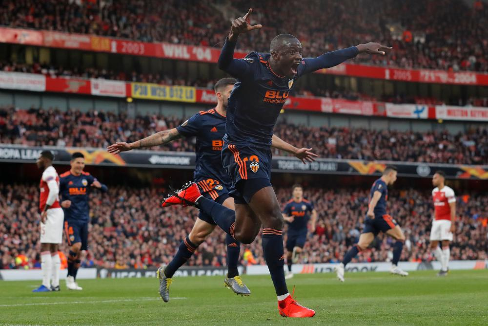 Mouctar Diakhaby of Valencia celebrates after opening the scoring.
