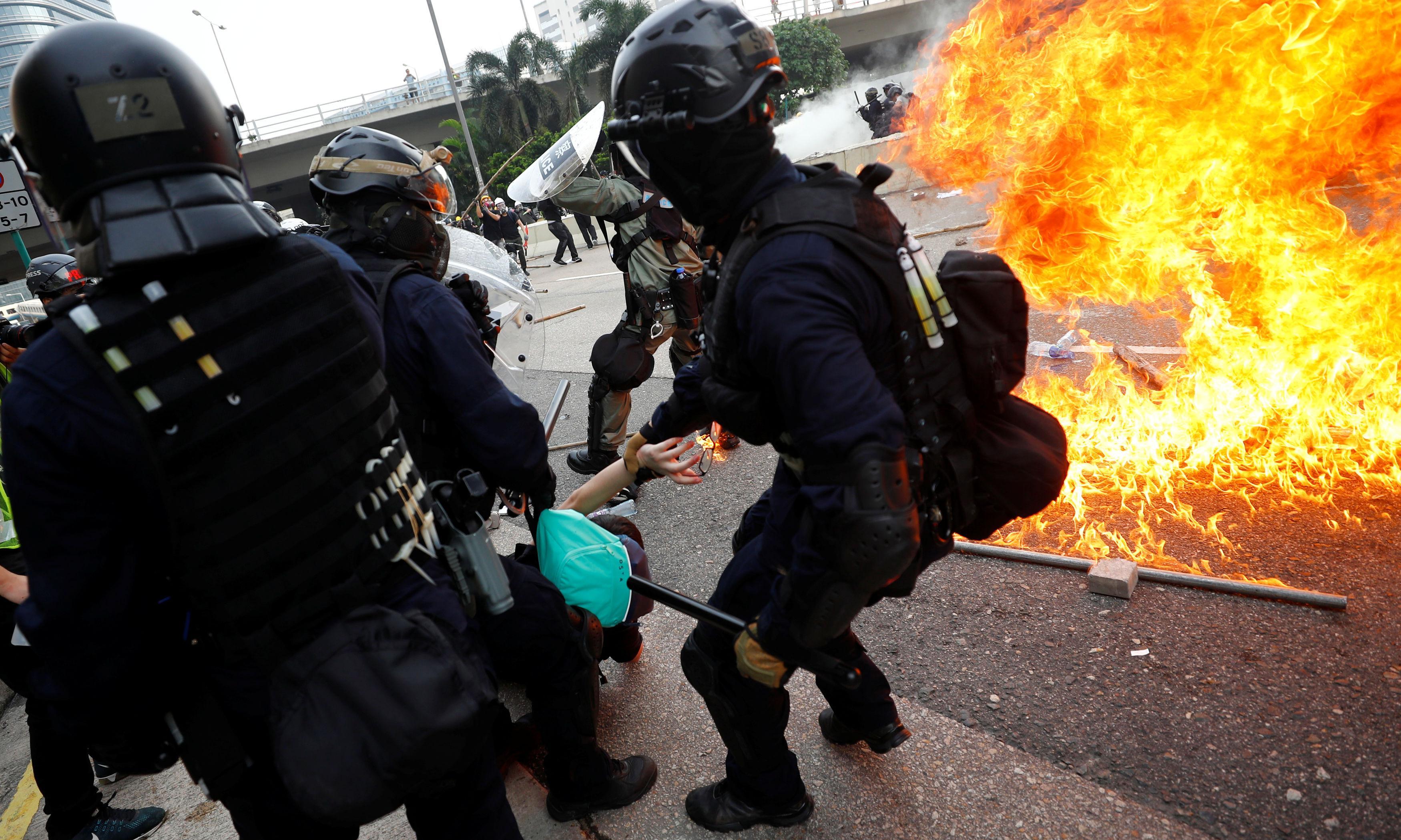 Hong Kong riot police beat protesters at anti-surveillance rally