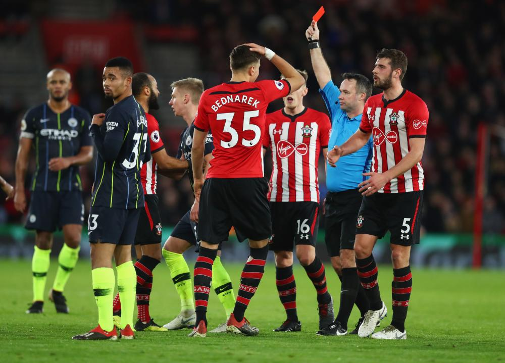 Pierre-Emile Hojbjerg of Southampton (not pictured) is shown a red card