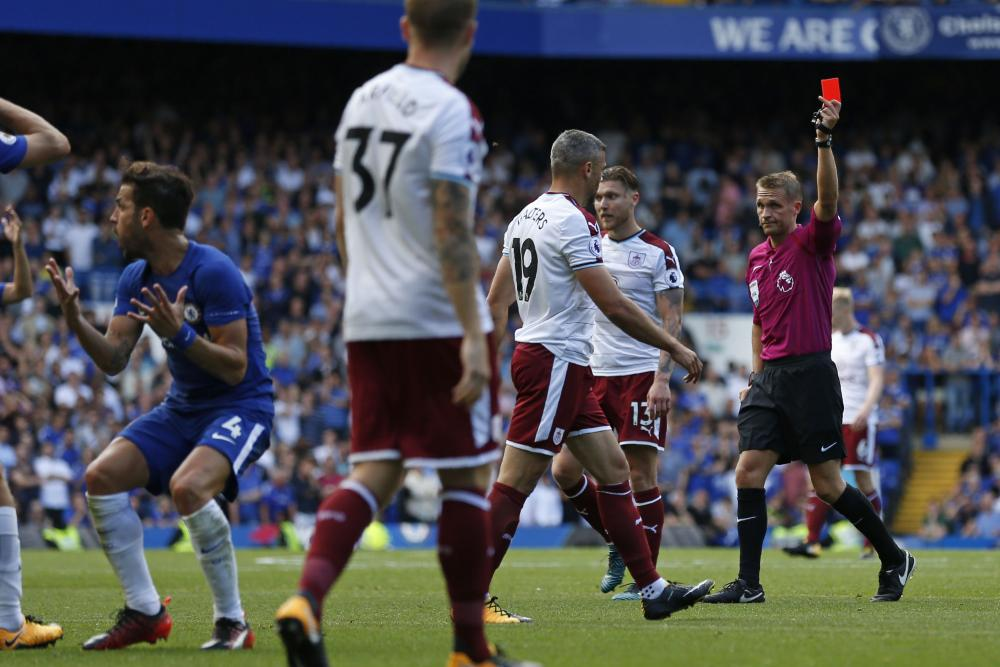 Craig Pawson shows the red card to a disbelieving Cesc Fabregas.