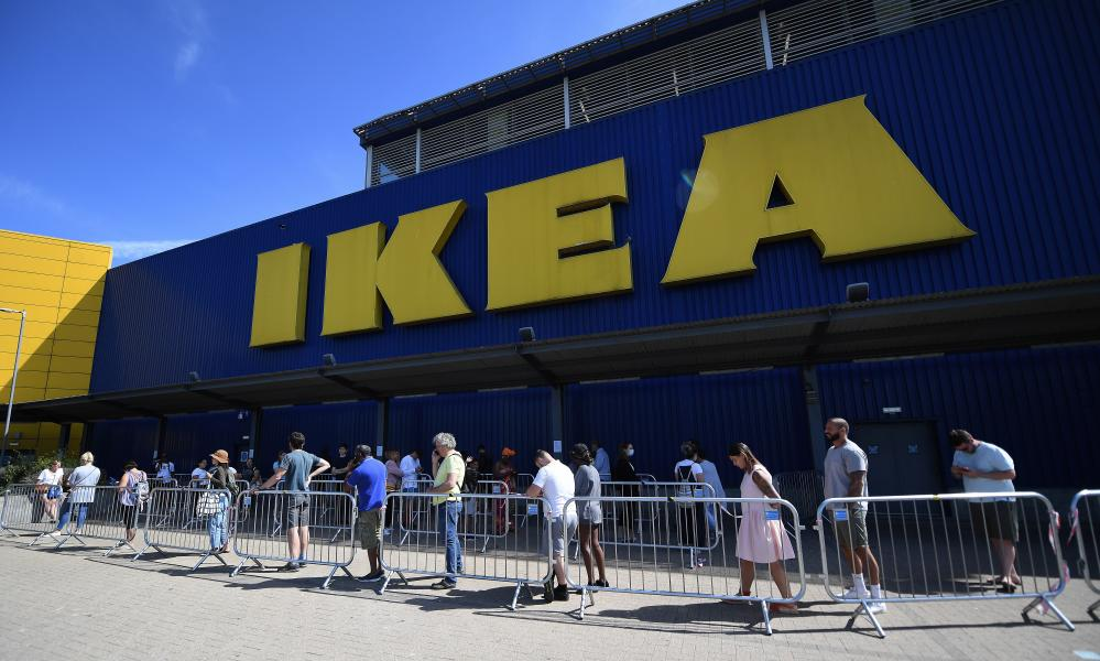 Customers queue outside an Ikea store in London, Britain as its doors reopened to the public on 1 June.