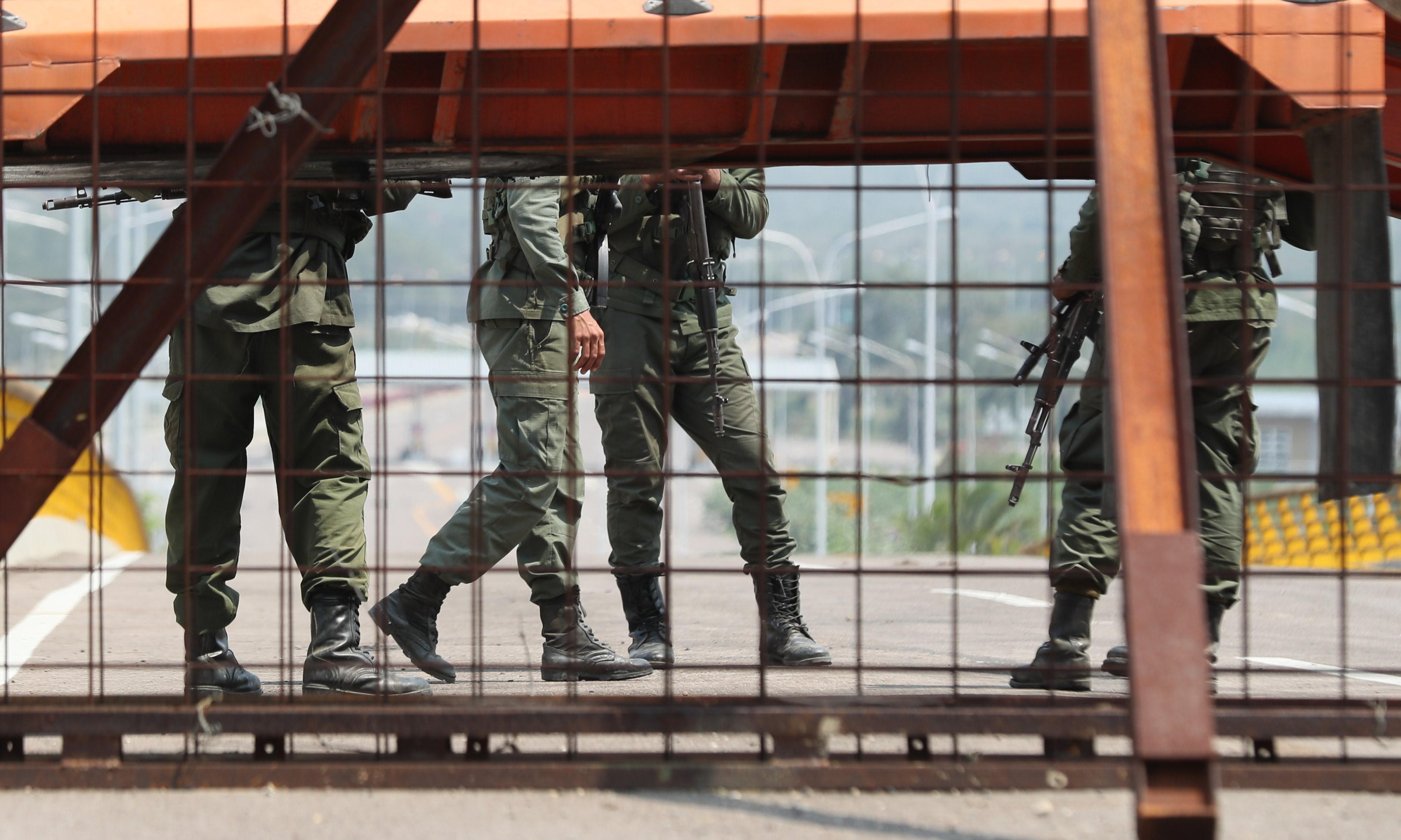 Venezuelan troops blockade bridge to stop aid from Colombia