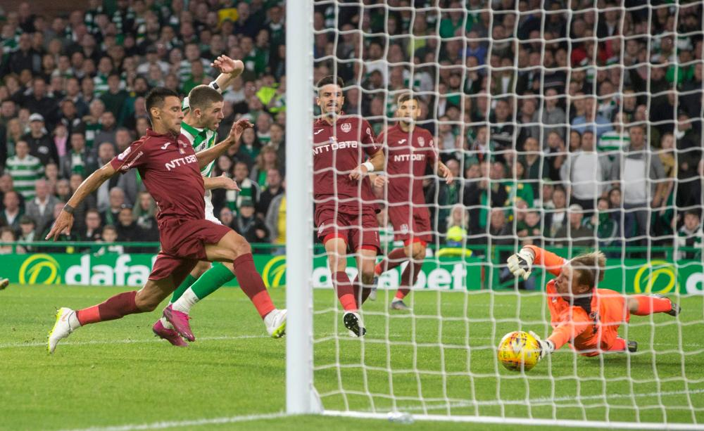 Ryan Christie score Celtic's third to retake the lead.