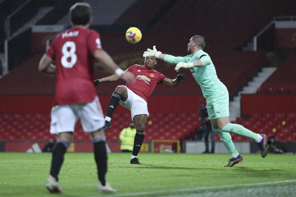 West Bromwich Albion's goalkeeper Sam Johnstone thwarts Manchester United's Anthony Martial.