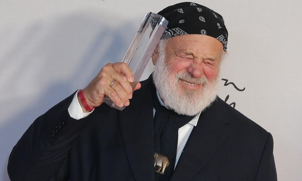 Photographer Bruce Weber poses with his award after being named winner of the Isabella Blow Award for Fashion Creator award.