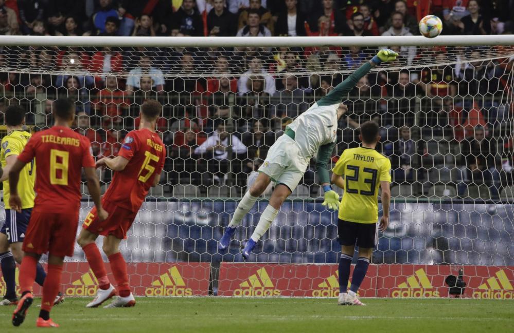 Scotland's goalkeeper David Marshall pushes away one of Belgium's 8 goal attempts.