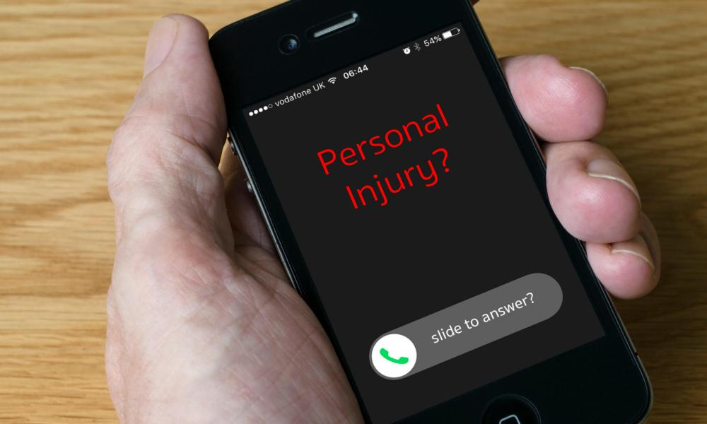 Phone with text message reading 'personal injury?'