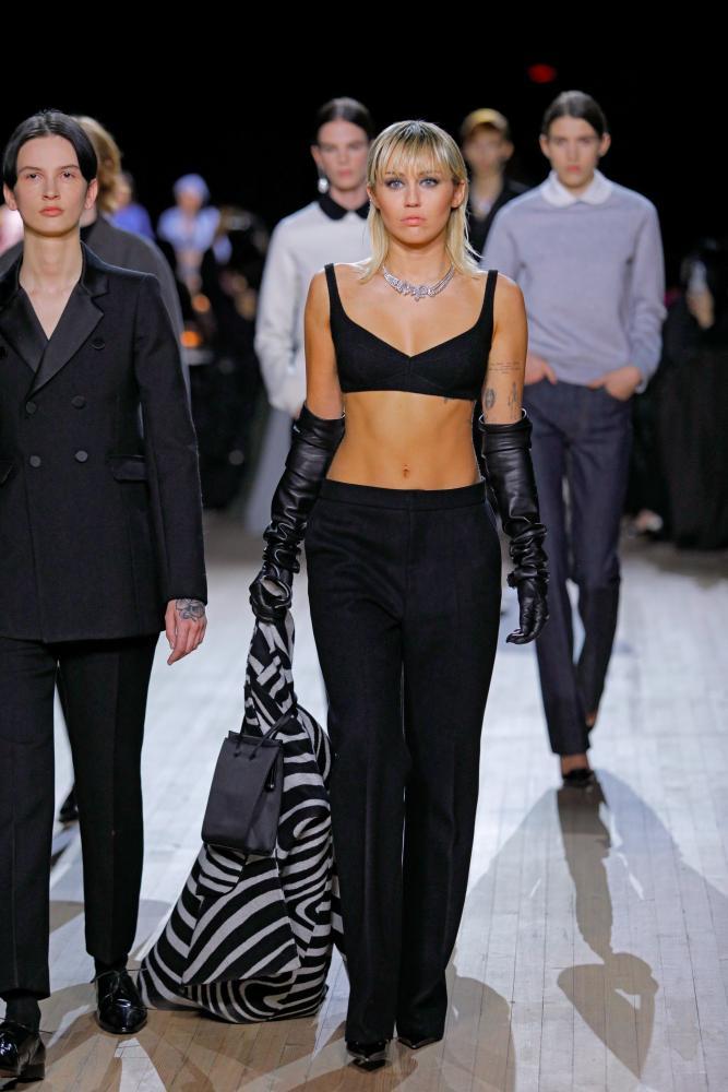 Miley Cyrus walks the catwalk.