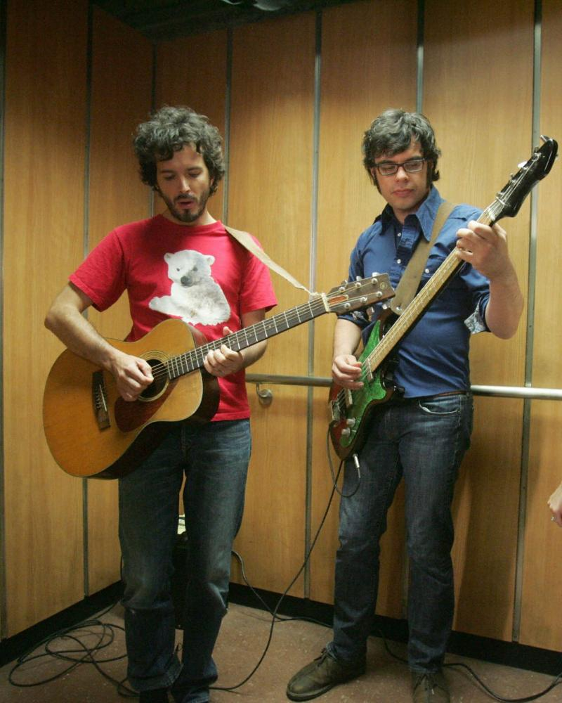 A scene from the TV series of the Conchords playing a gig in a lift.
