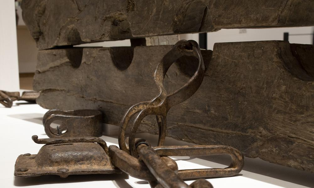 Tronco, or multiple foot stocks, used to to constrain enslaved people, on display at the slavery exhibition at the Rijksmuseum in Amsterdam.