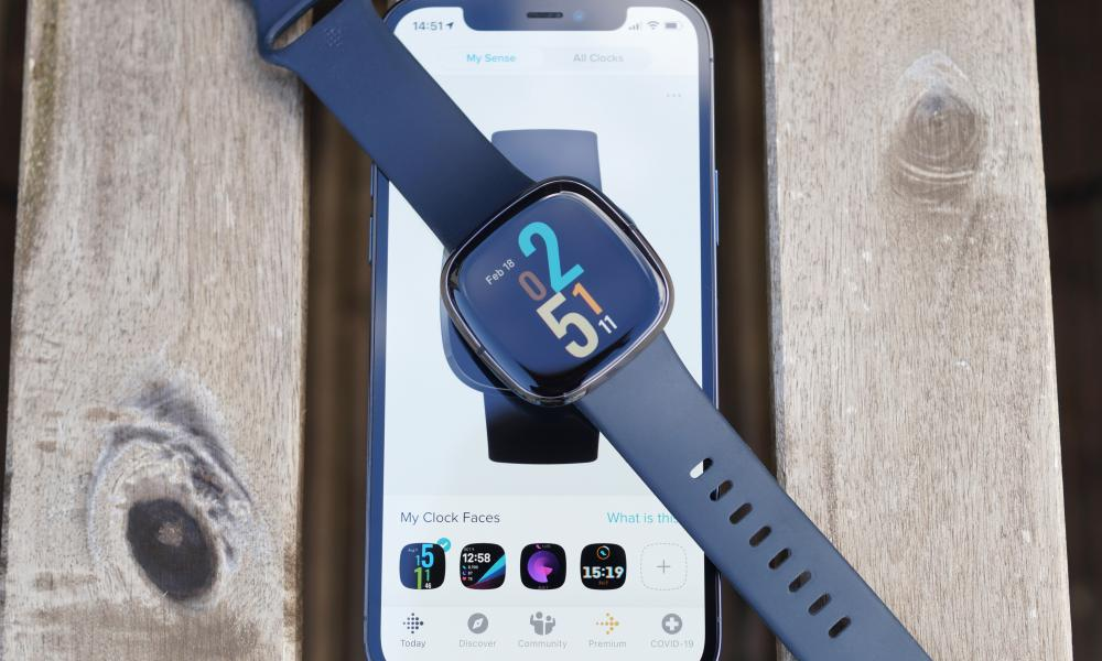 Fitbit Sense on top of smartphone