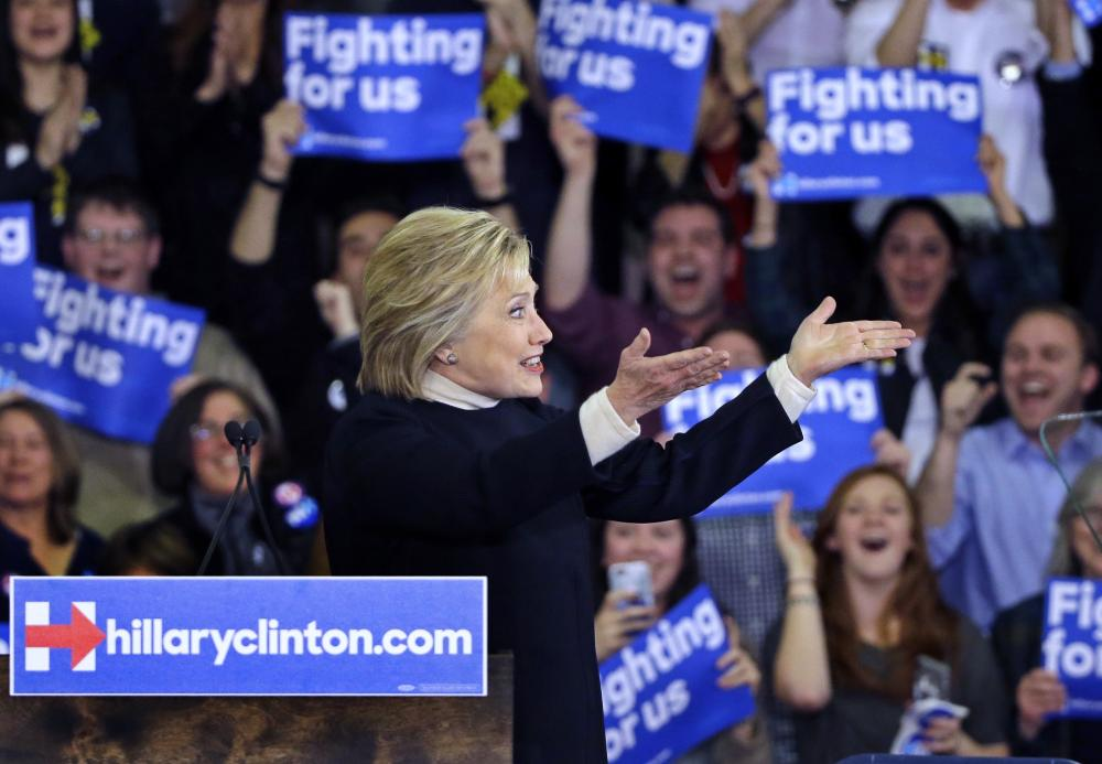 Hillary Clinton gestures to supporters at her New Hampshire presidential primary campaign rally.