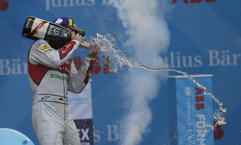 Motorsports driver Daniel Abt sprays champagne after winning a race in Mexico.