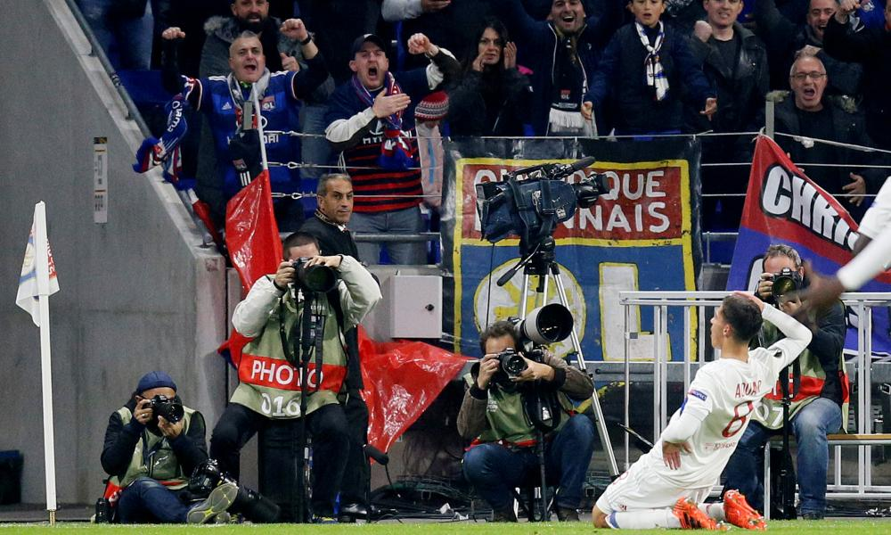 Houssem Aouar strikes a pose as he celebrates scoring their second goal in front of some rather happy Lyon fans,