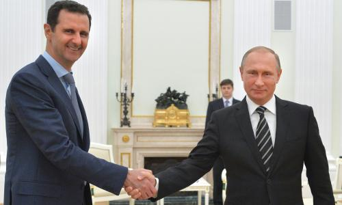 Russian President Vladimir Putin, right, shakes hand with Syria President Bashar Assad in the Kremlin in Moscow, Russia.