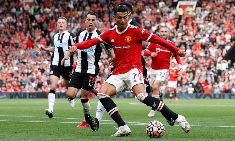 Manchester United's Cristiano Ronaldo scores their second goal.