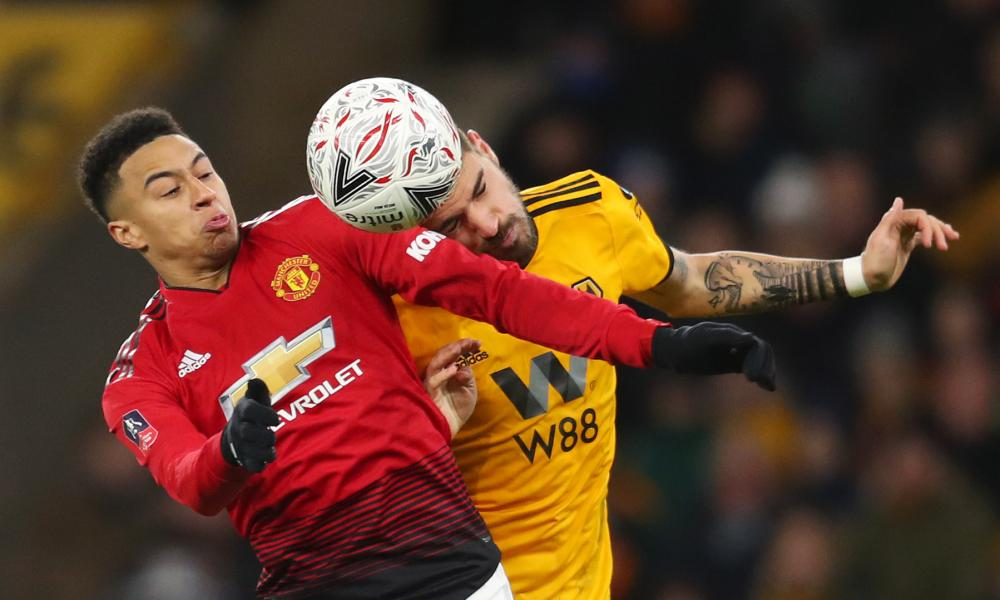 Jesse Lingard challenged by Rúben  Neves of Wolves