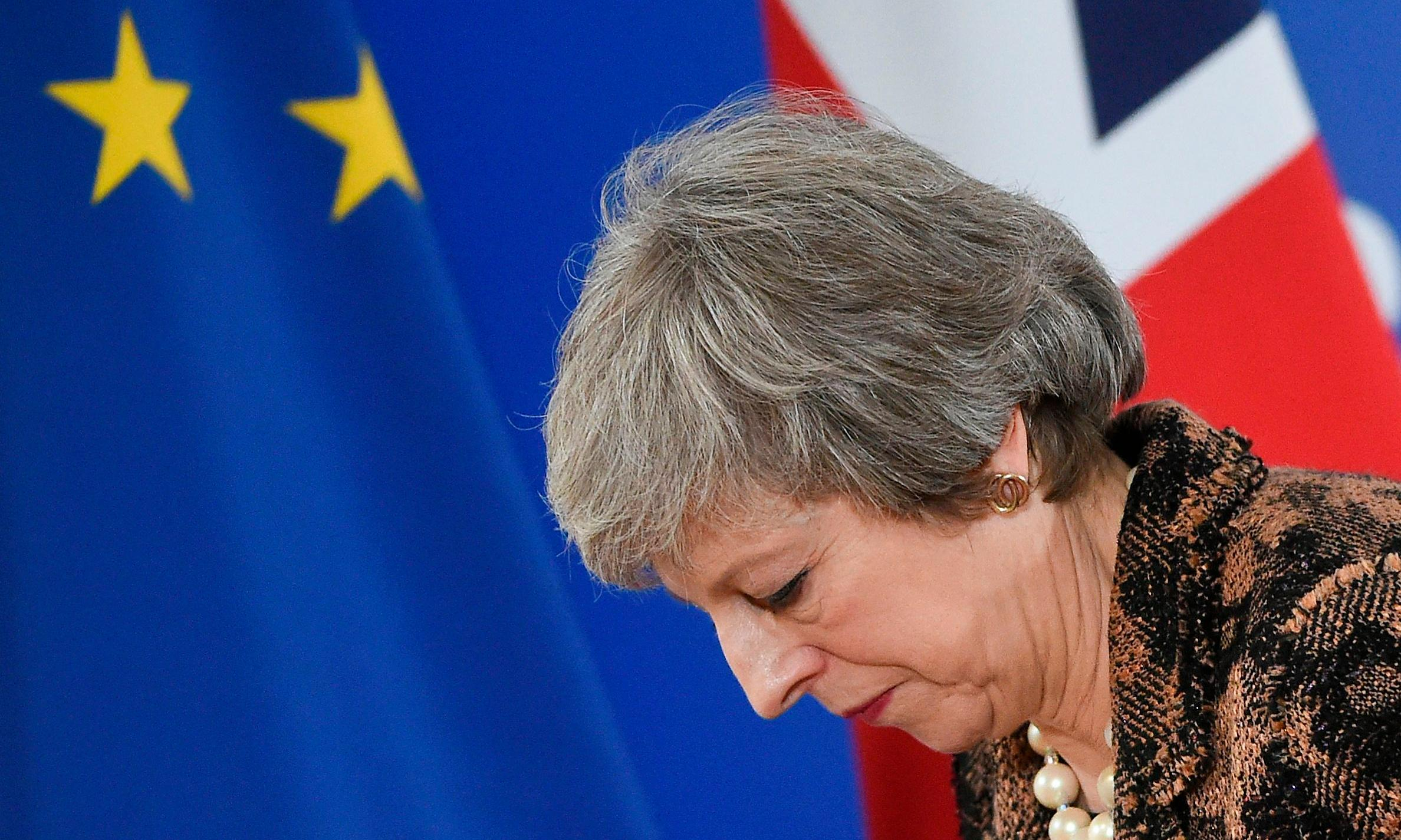 May pulls off 'le backwards' in Brussels and heads for Pizza Hut stardom