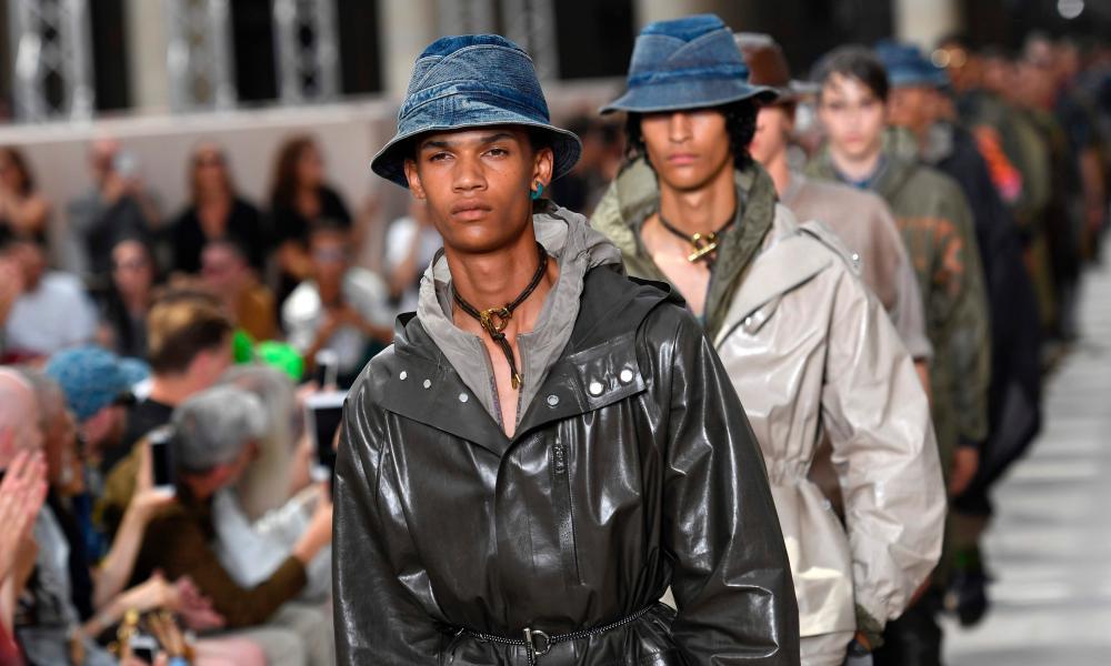 Models in Louis Vuitton trenchcoats.