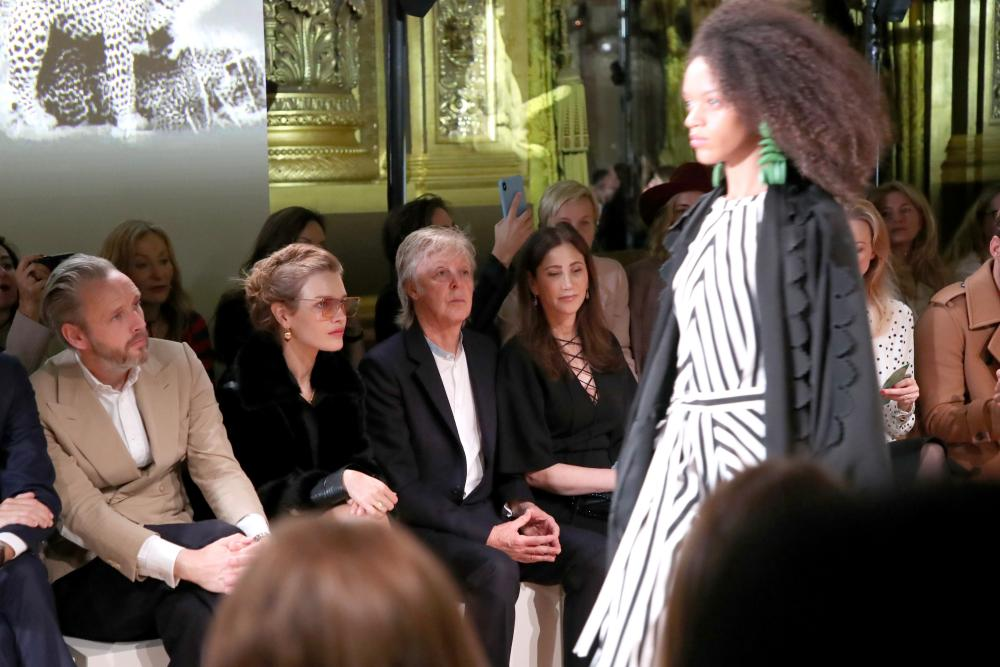 Alasdhair Willis, Natalia Vodianova, Sir Paul McCartney and his wife Nancy Shevell on the front row.