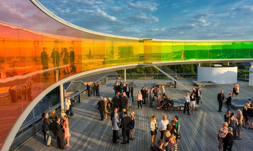 Conference participants mingle below the rainbow panorama at the roof of Aros Art Museum, Aarhus, Denmark.