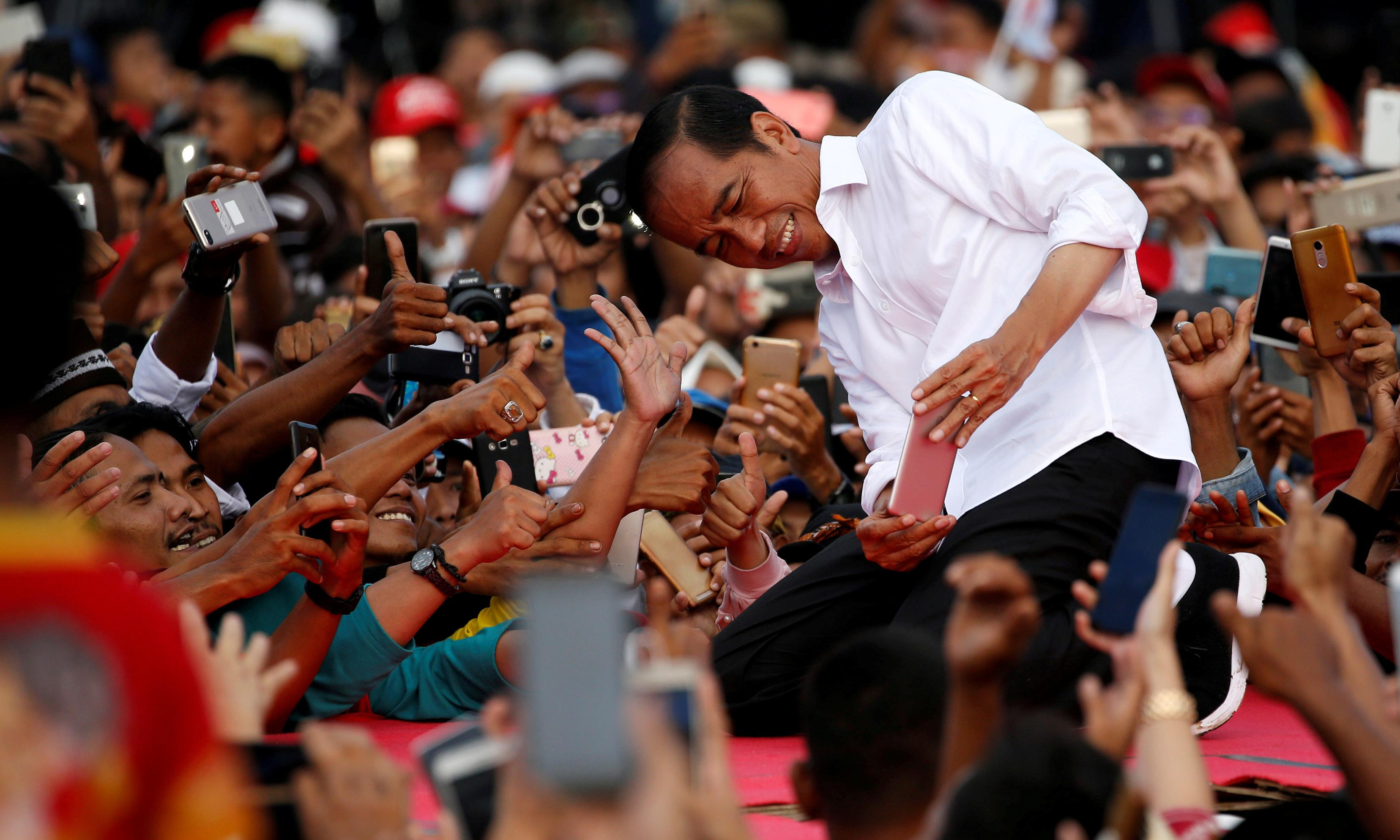 Indonesia election: official count hands victory to Joko Widodo as rival cries foul