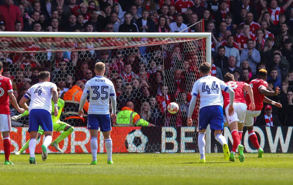 Britt Assombalonga scores from the spot to make it 1-0 Forest.