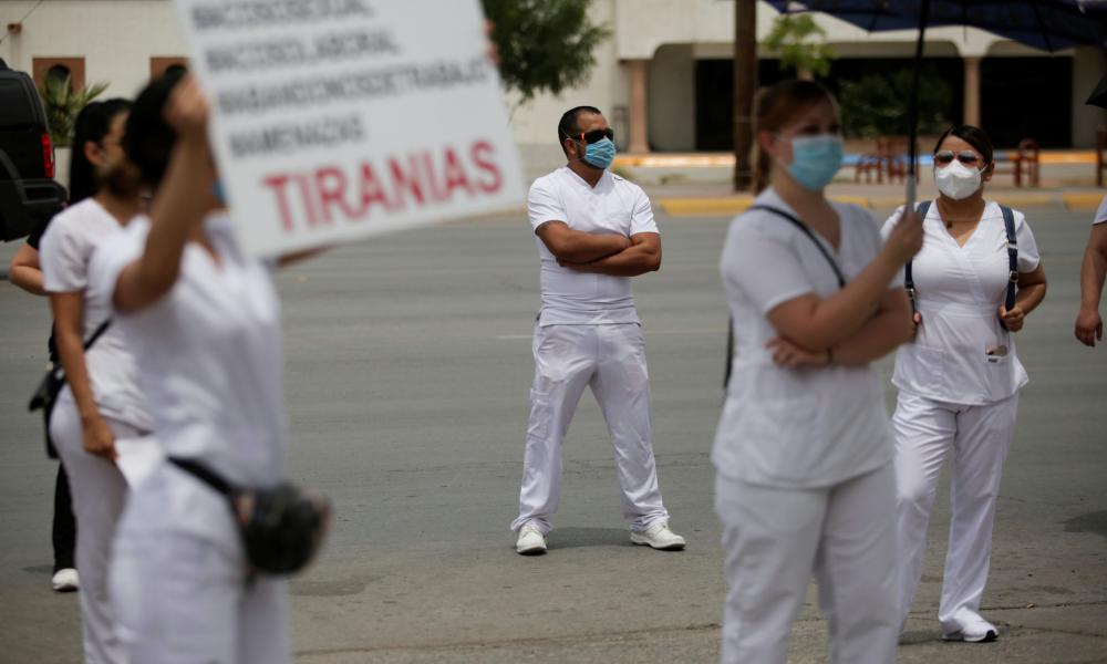 Healthcare workers protest because of a payment dispute outside of Woman's Hospital, which is treating patients with the coronavirus disease in Ciudad Juarez, Mexico 11 May 2020.