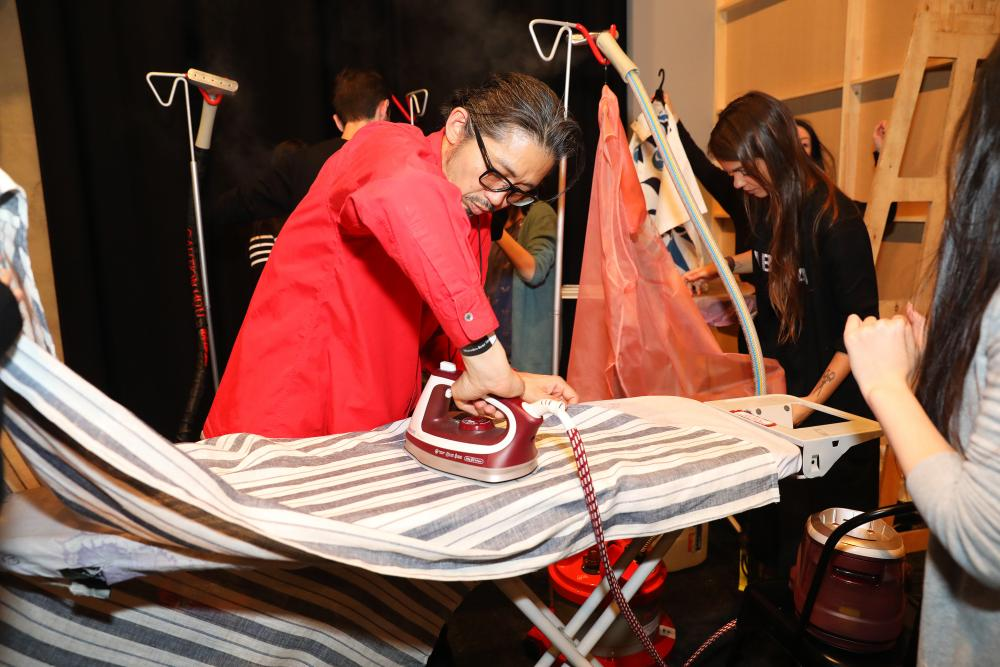 Akira Isogawa ironing clothes backstage at his show at Australia fashion week in May 2017.