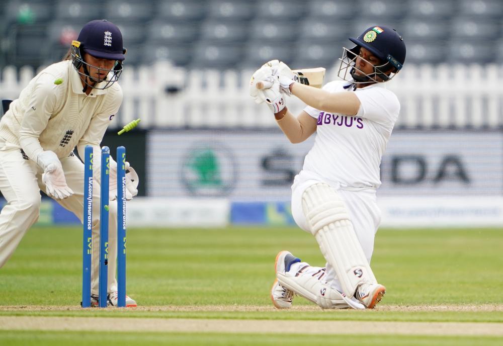 India's Deepti Sharma is bowled.