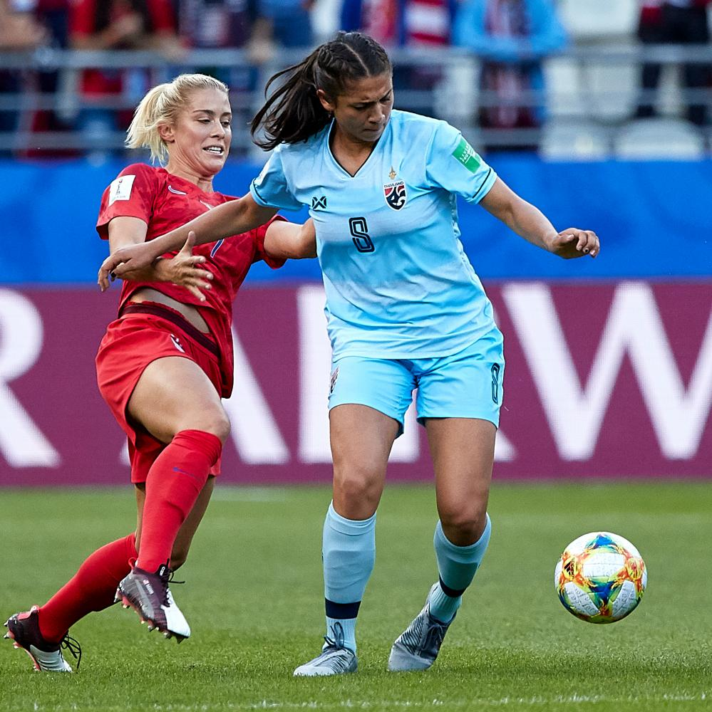 Miranda Nild, right, tries to keep the ball against the USA's Abby Dahlkemper, who played her college soccer just down the coast from Nild at UCLA.